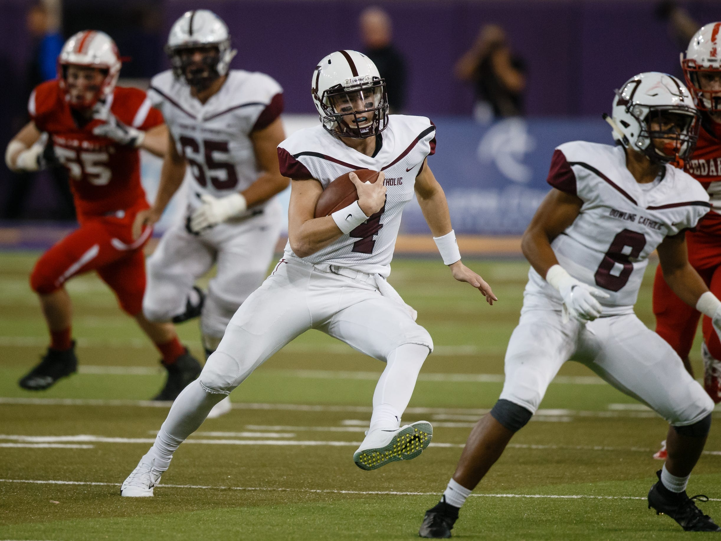 Dowling Catholic's Zach Watters (4) runs the ball during their class 4A state championship football game on Friday, Nov. 16, 2018, in Cedar Falls. Dowling Catholic would go on to defeat Cedar Falls 22-16 and win their sixth state title.
