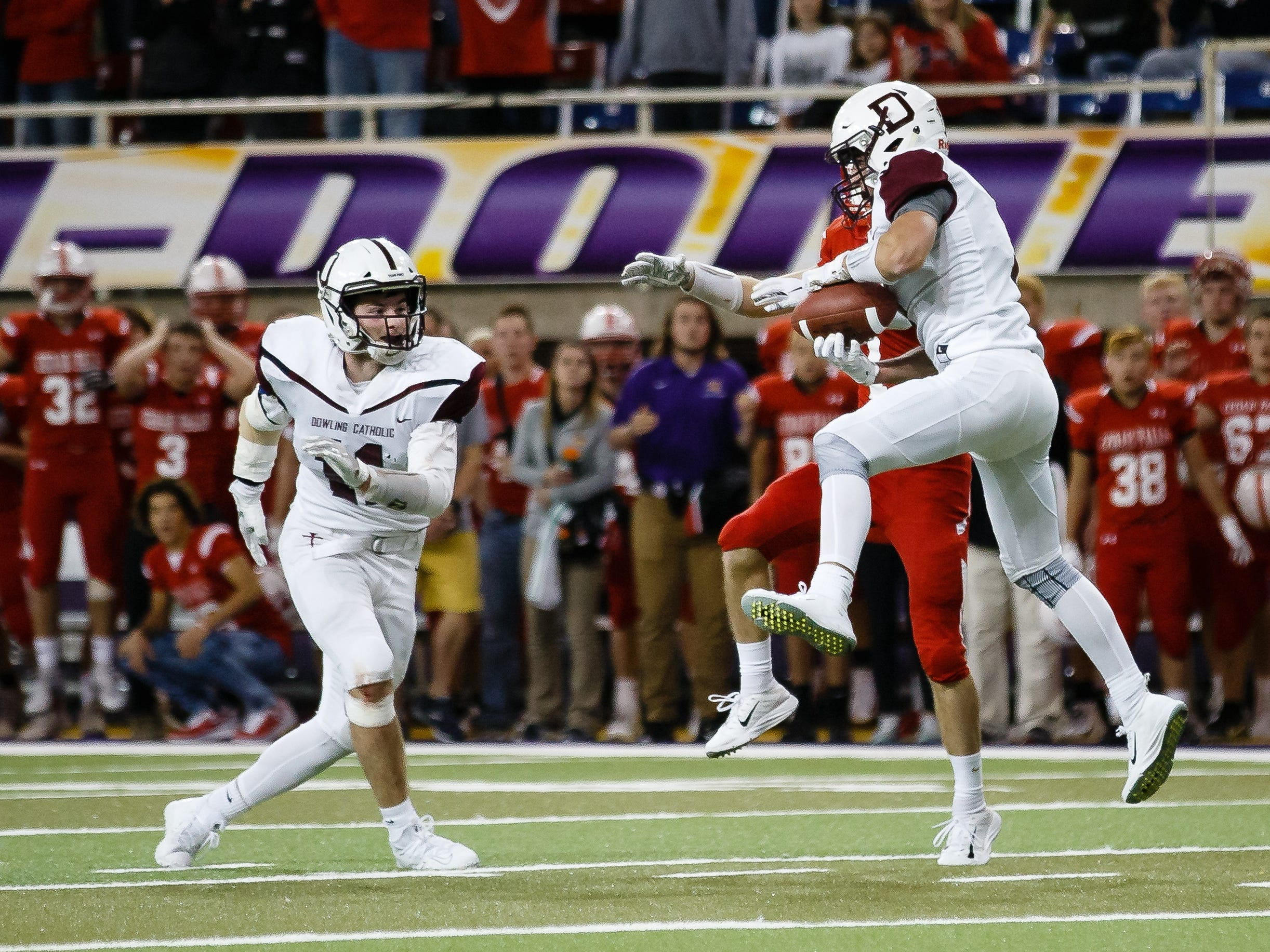 Dowling Catholic's Connor Jackman (7) intercepts a pass to seal the win for Dowling Catholic, 22-16 over Cedar Falls during their class 4A state championship football game on Friday, Nov. 16, 2018, in Cedar Falls.