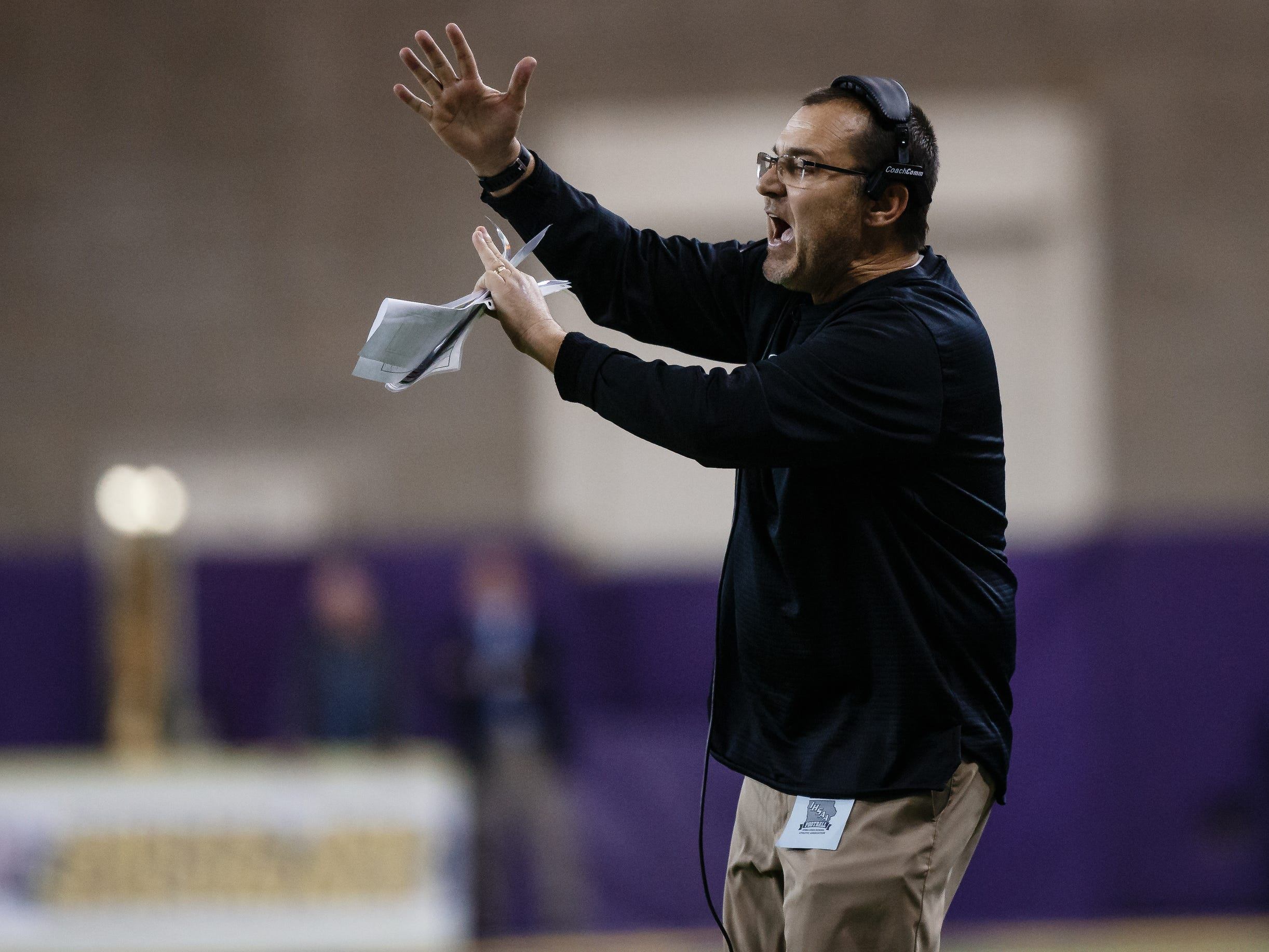 Dowling Catholic head coach Tom Wilson calls for a time out during their class 4A state championship football game on Friday, Nov. 16, 2018, in Cedar Falls. Dowling Catholic would go on to defeat Cedar Falls 22-16 and win their sixth state title.