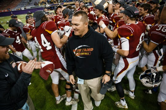 PCM head coach Greg Bonnett lets his team celebrate after the Mustangs defeated Boyden-Hull/Rock Valley 28-7 to win the class 2A state championship football game on Friday, Nov. 16, 2018, in Cedar Falls.