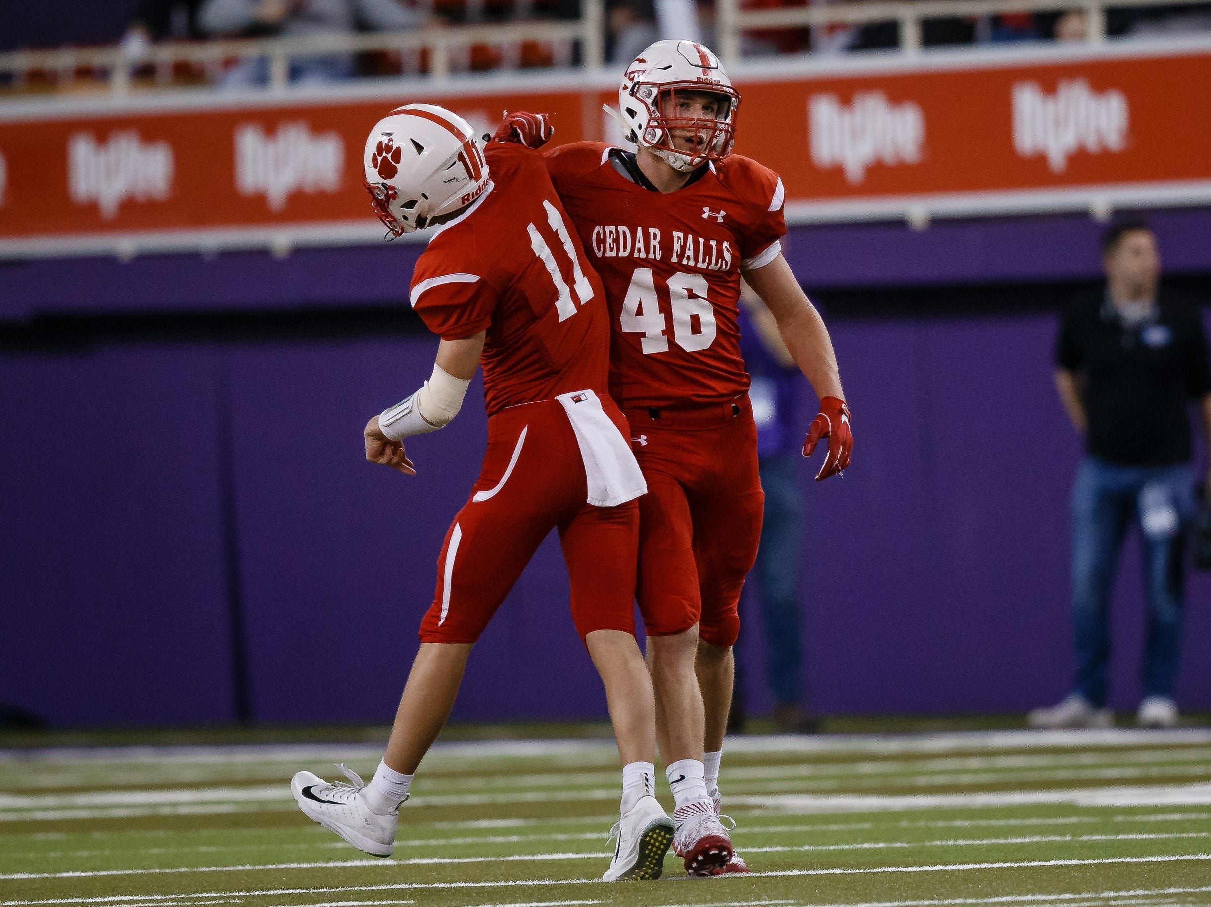 Cedar Falls's Jack Campbell (46) celebrates a bit hit with Cedar Falls's Ben Sernett (11) during their class 4A state championship football game on Friday, Nov. 16, 2018, in Cedar Falls. Cedar Falls takes a 13-7 lead into halftime.