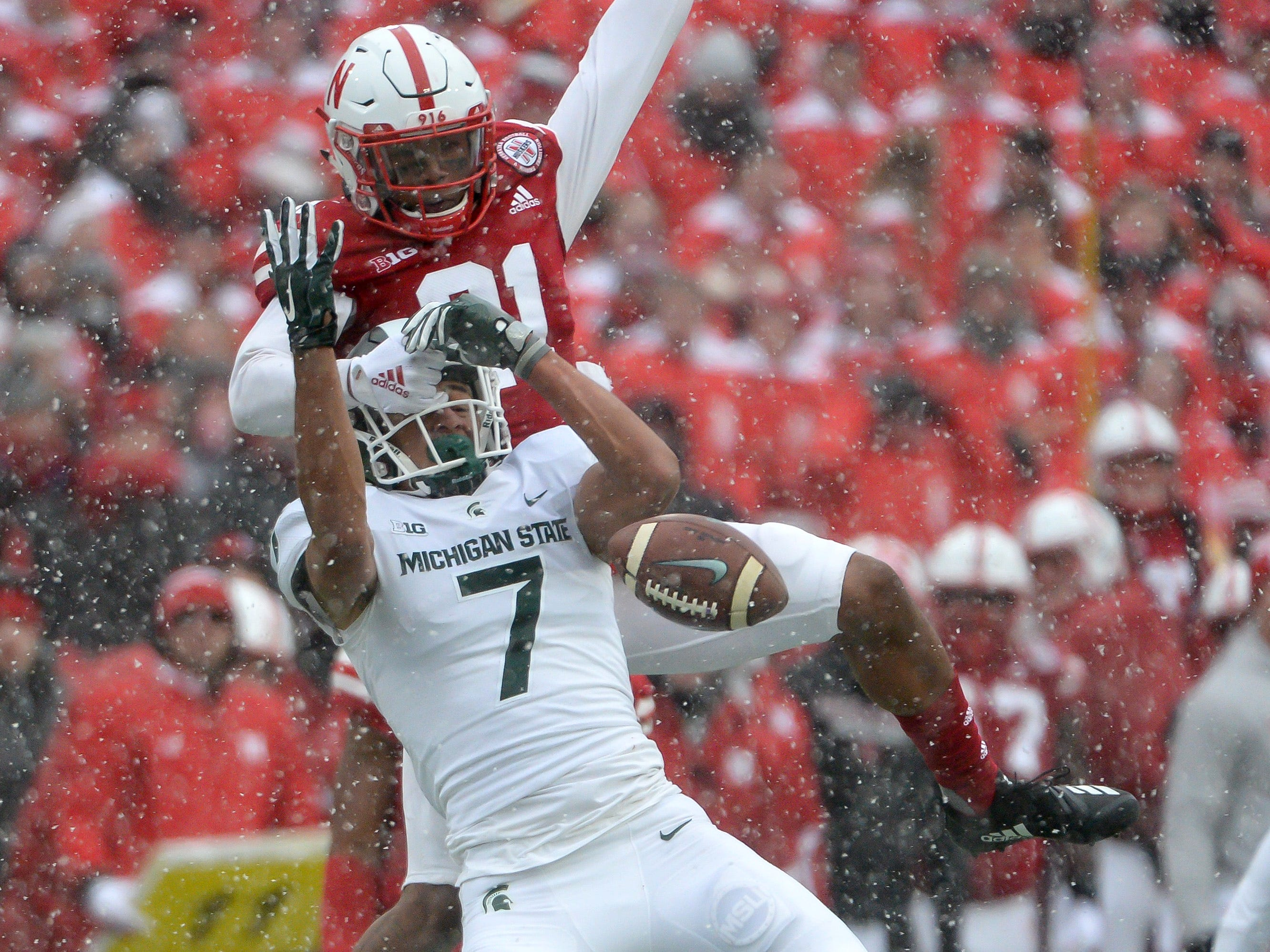 Nebraska defensive back Lamar Jackson interferes with Michigan State receiver Cody White on a pass in the second half at Memorial Stadium on Nov. 17, 2018 in Lincoln, Neb.