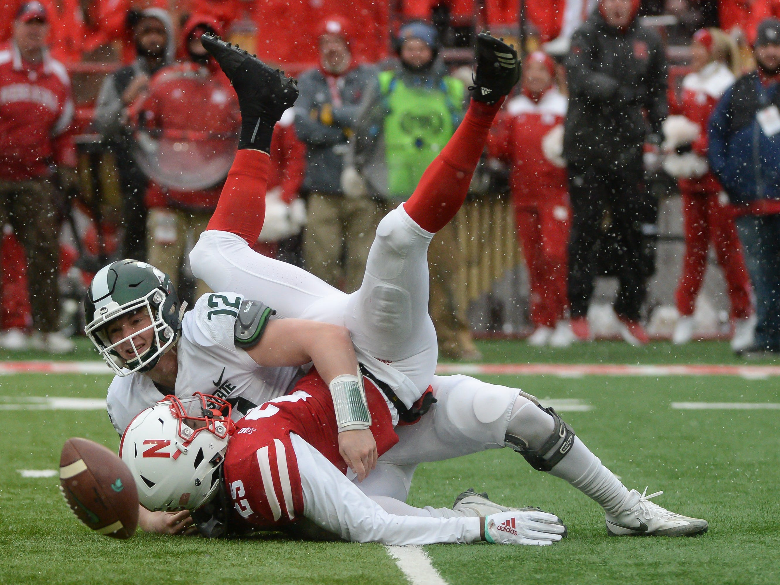 Michigan State quarterback Rocky Lombardi fumbles on a sack by Nebraska's Antonio Reed in the second half at Memorial Stadium on Nov. 17, 2018 in Lincoln, Neb.