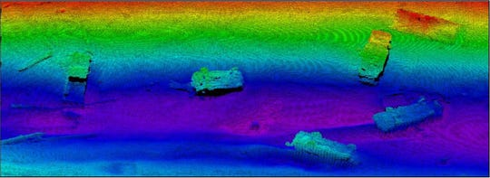 Dumped vehicles are seen in this side-scan sonar image of a channel off the Rouge River near Zug Island.