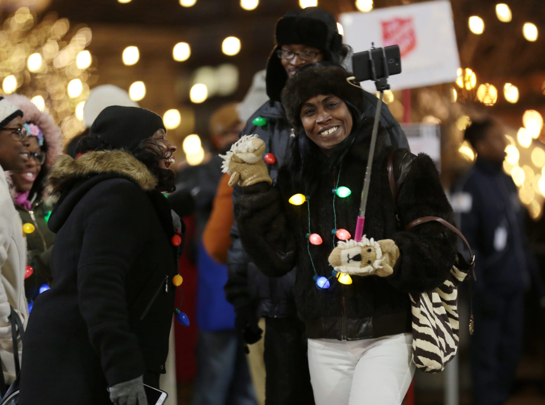 Jenell Brown of Detroit takes a selfie while gathered with family during the annual tree lighting event at Campus Martius Park in downtown Detroit on Friday, November 16, 2018.