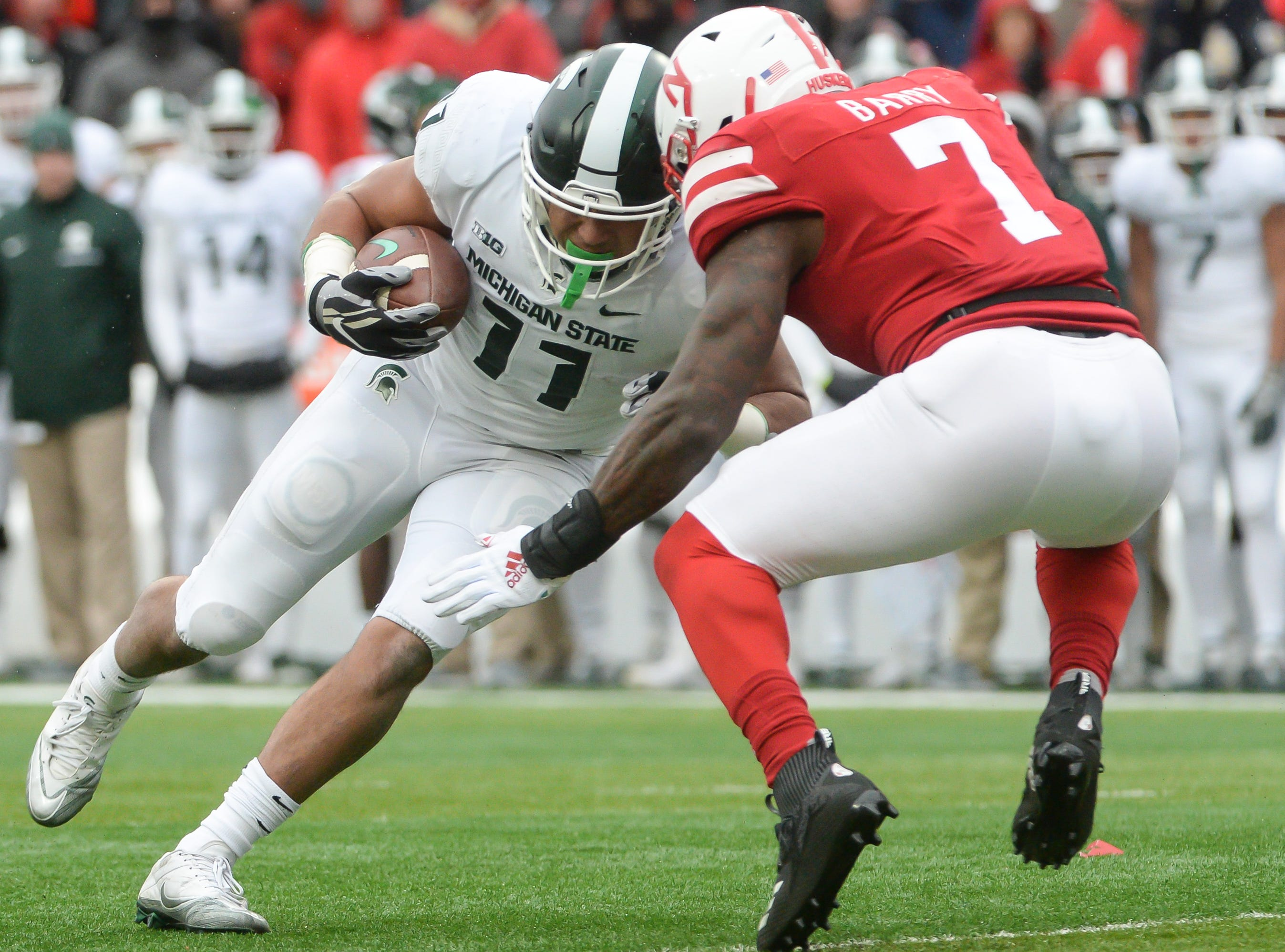 Michigan State running back Connor Heyward drives for additional yards against Nebraska linebacker Mohamed Barry on Saturday, Nov. 17, 2018, in Lincoln, Neb.