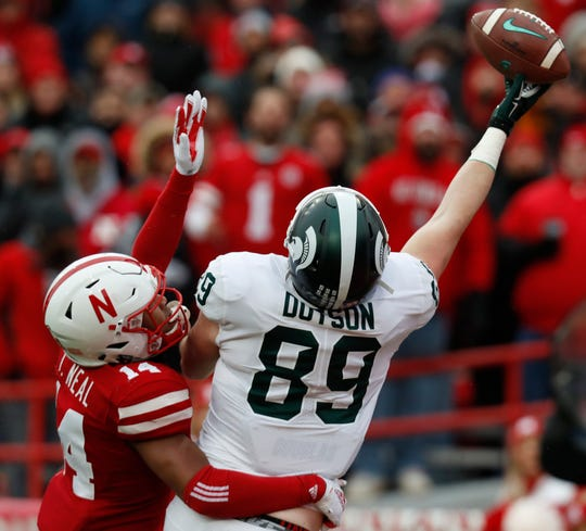 Michigan State tight end Matt Dotson cannot haul in this touchdown pass against Nebraska safety Tre Neal in the first half on Saturday, Nov. 17, 2018, in Lincoln, Neb.