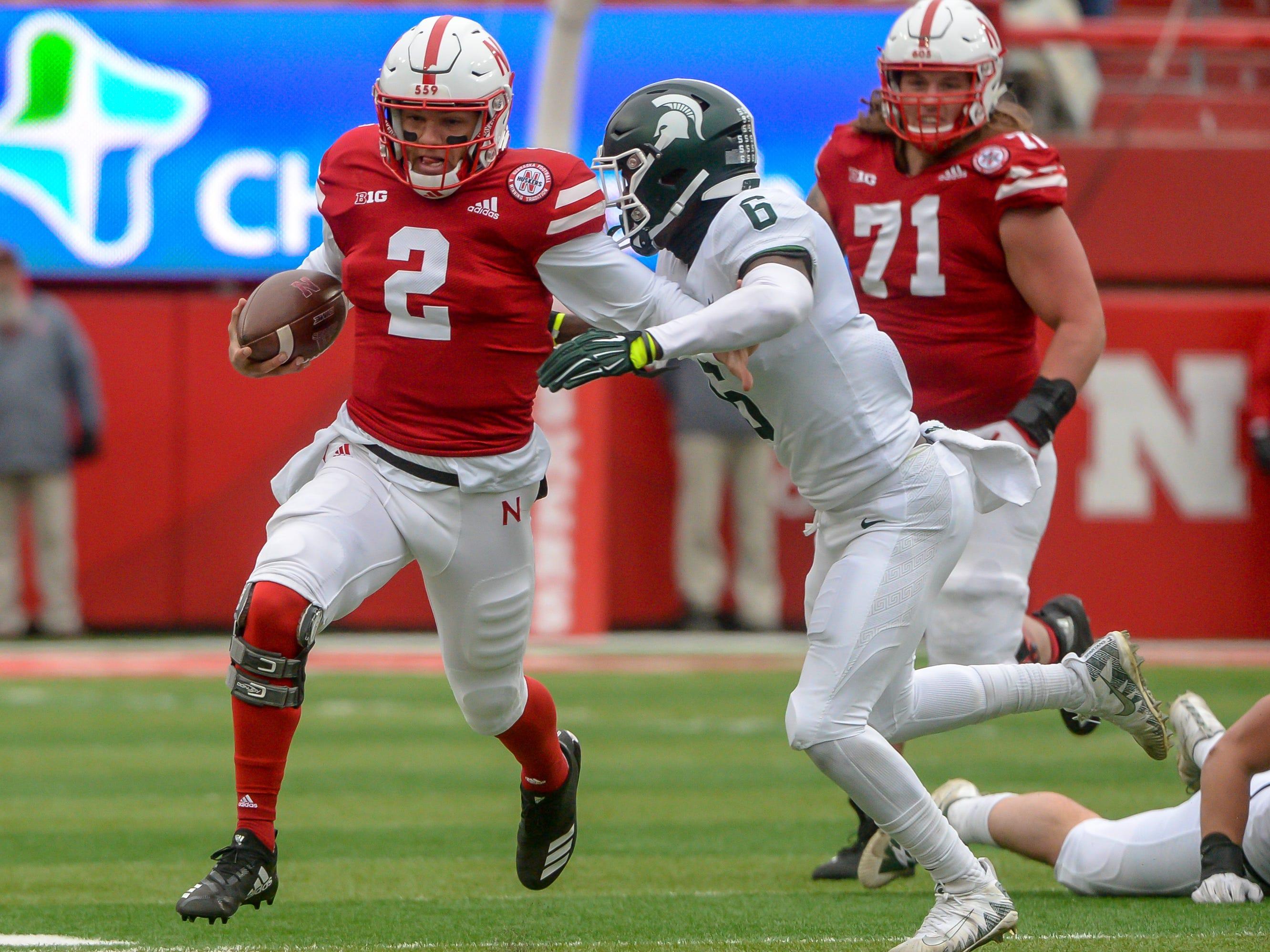 Nebraska quarterback Adrian Martinez runs against Michigan State safety David Dowell in the first half.
