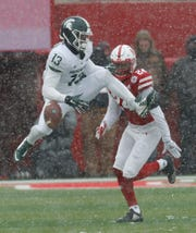 Laress Nelson drops a pass against Nebraska in the fourth quarter last year.