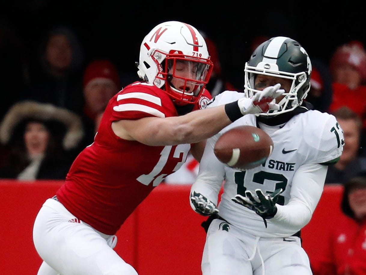 Michigan State wide receiver Mickey Macius catches the pass against Nebraska safety JoJo Domann in the first half on Saturday, Nov. 17, 2018, in Lincoln, Neb.