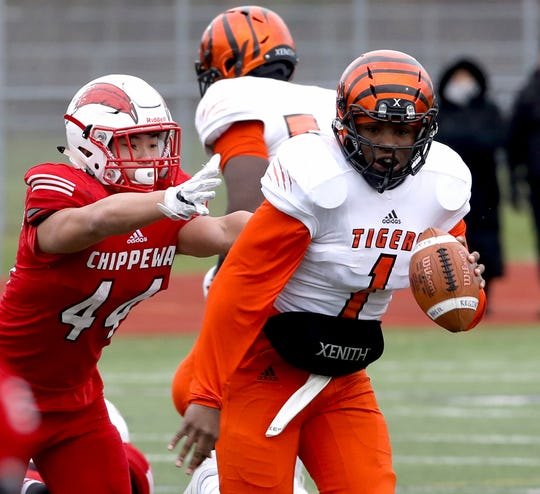 Junior Christian Dhue-Reid (1) returns for his third season as Belleville's starting quarterback.