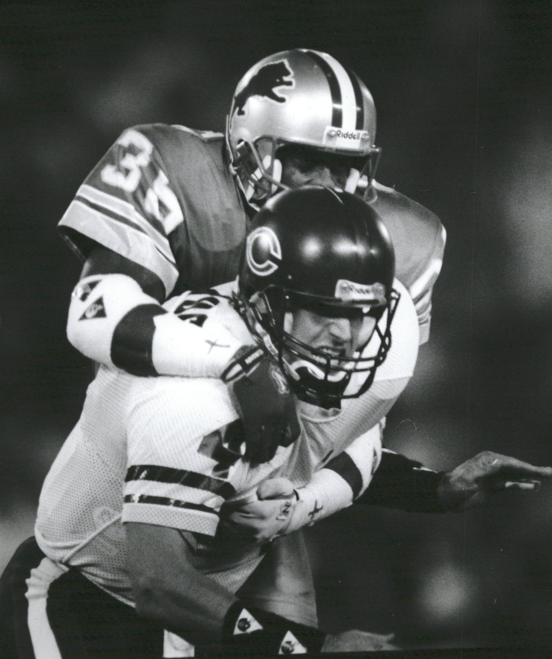 Former Michigan quarterback Jim Harbaugh fumbled twice and threw four interceptions in a Thanksgiving loss to the Lions in 1991.