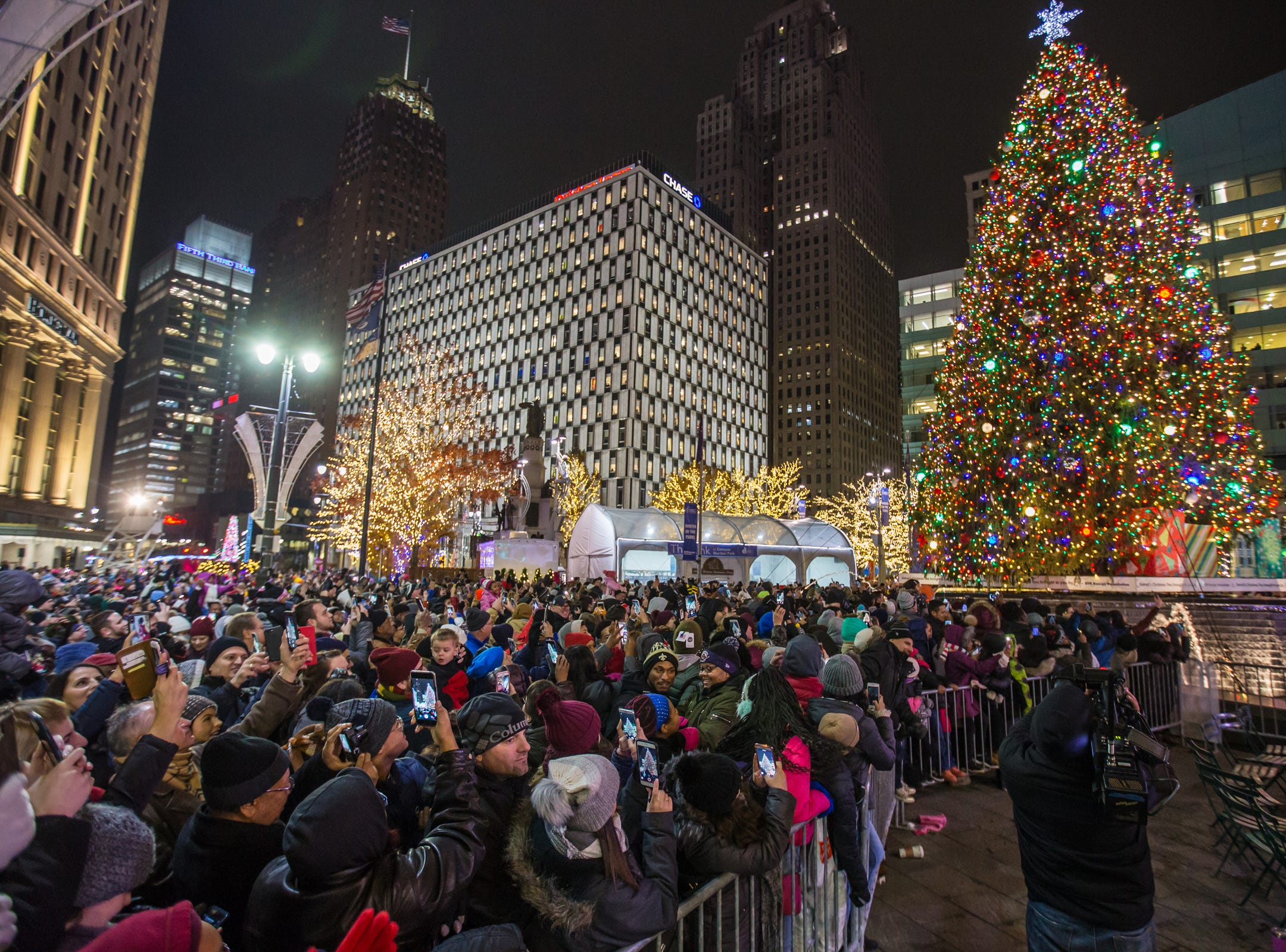 People take photos as the tree is lit during the annual tree lighting event at Campus Martius Park in downtown Detroit on Friday, November 16, 2018.