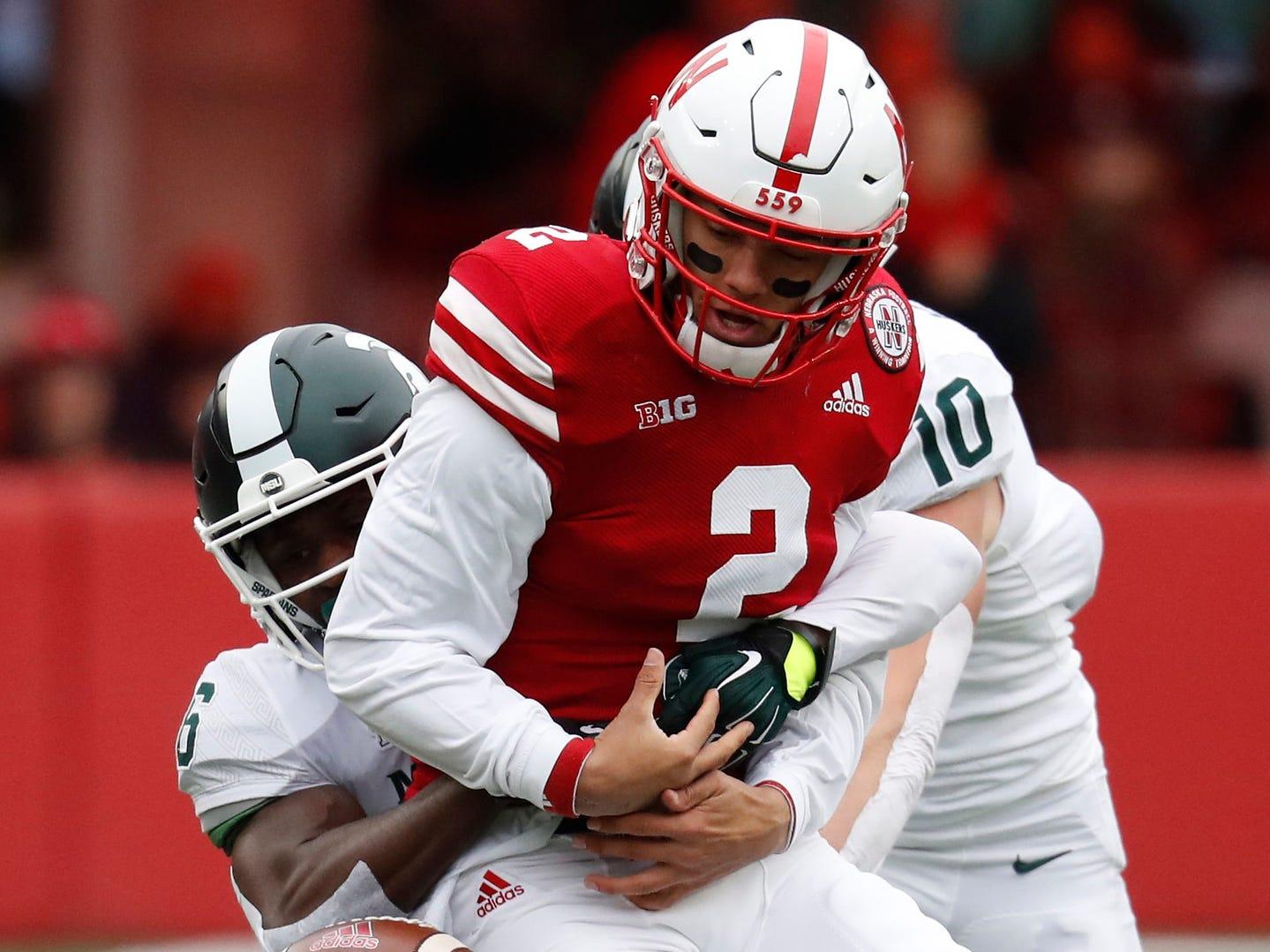 Nebraska quarterback Adrian Martinez fumbles the ball against Michigan State safety David Dowell in the first half at Memorial Stadium.
