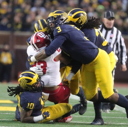 Michigan's Rashan Gary (3) and Devin Bush (10) tackle Indiana's Ronnie Walker in the first half Saturday, Nov. 17, 2018 at Michigan Stadium in Ann Arbor.