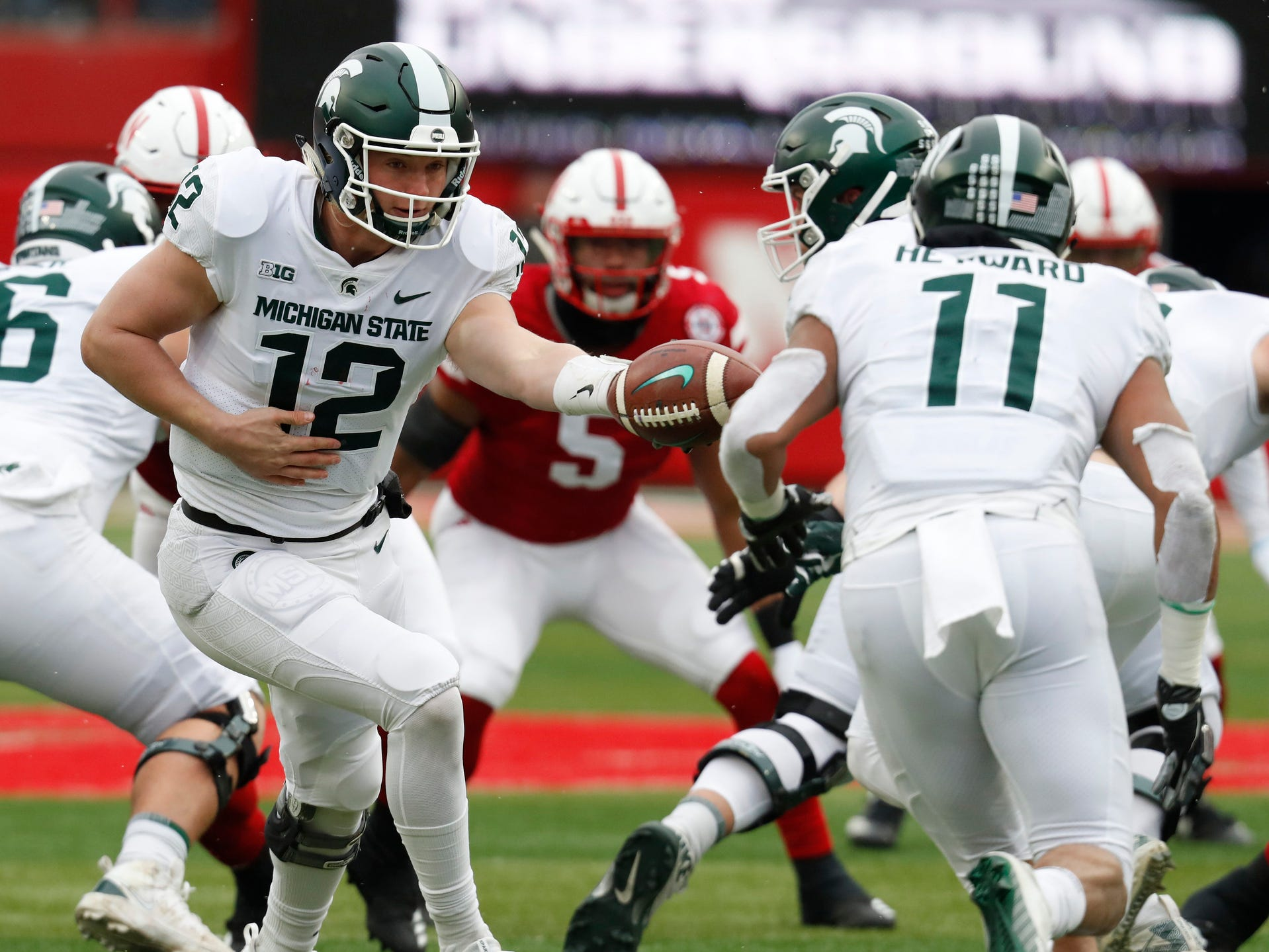 Michigan State quarterback Rocky Lombardi hands off to running back Connor Heyward during the game against Nebraska in the first half on Saturday, Nov. 17, 2018, in Lincoln, Neb.