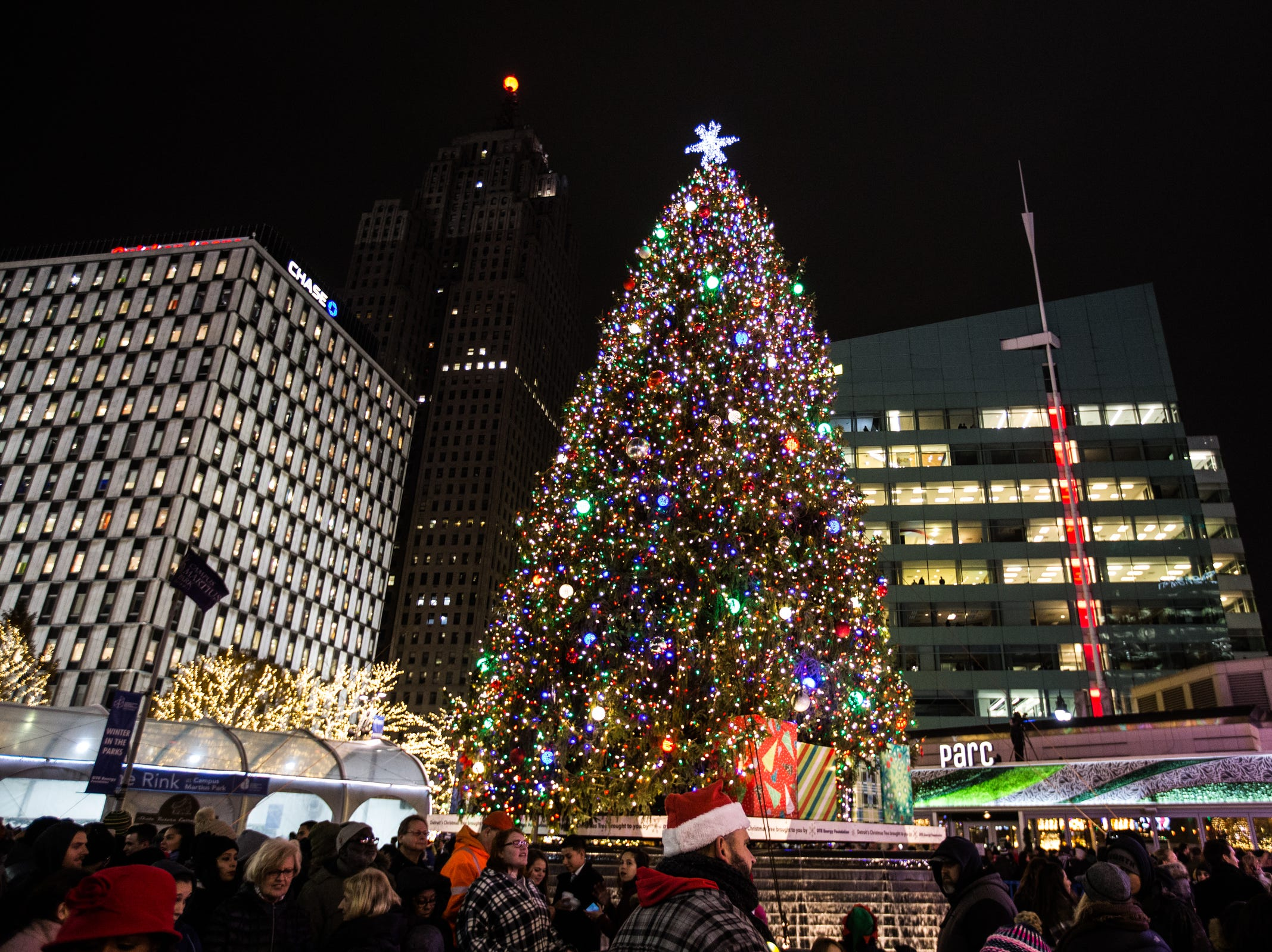 People take photos during the annual tree lighting event at Campus Martius Park in downtown Detroit on Friday, November 16, 2018.