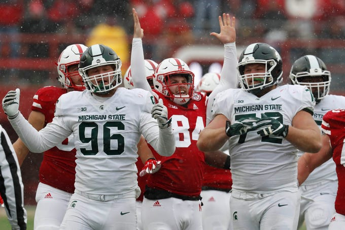 Nebraska long snapper Jordan Ober (84) celebrates the go-ahead field goal against Michigan State's Jacob Panasiuk (96) and Mike Panasiuk (72) in the second half at Memorial Stadium on Nov. 17, 2018 in Lincoln, Neb.