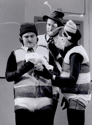 """John Belushi, left, Chevy Chase and Gilda Radner perform as the Killer Bees on """"Saturday Night Live."""""""
