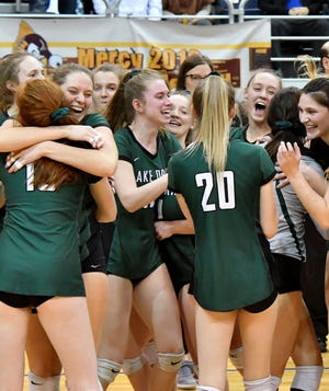 The Lake Orion players celebrate after they beat Farmington Hills Mercy, 3-2, in D1 semifinals.