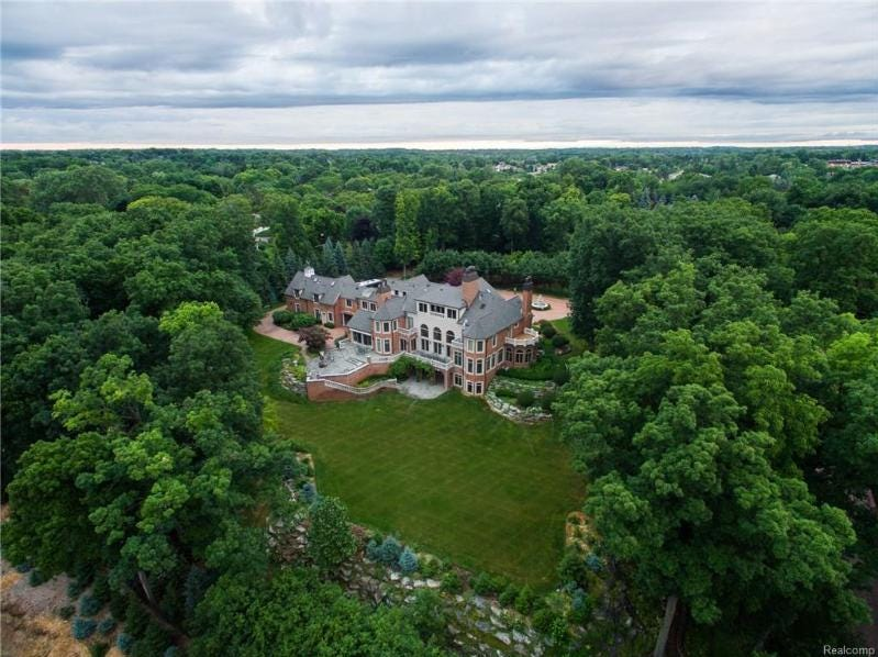 This colonial-style mansion in Northville, built in 2000, has a guard house, an elevator, a movie theater, a gym, seven bedrooms, seven full baths, two half-baths and a seven-car garage. The home is listed with Max Broock Realtors of Birmingham.