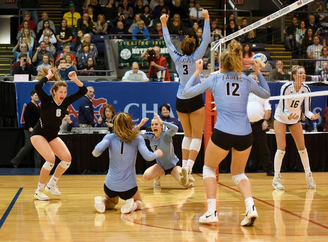 The Grand Rapids Christian volleyball team celebrates after winning in straight sets over Pontiac Notre Dame Prep in Division 2.