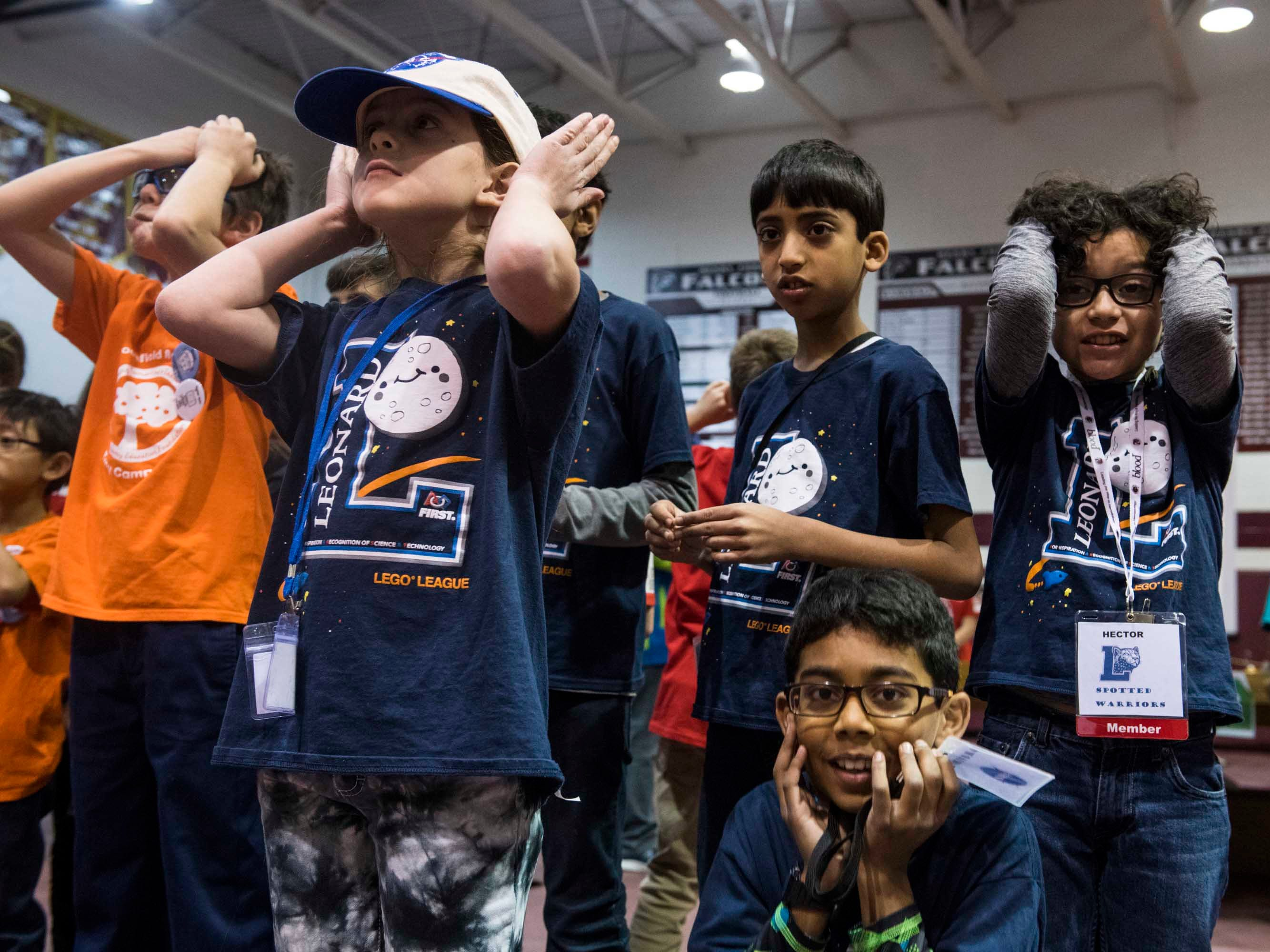 Members of the Spotted Warriors robotics team anxiously watch their teammates compete at the annual UCS ThunderQuest.