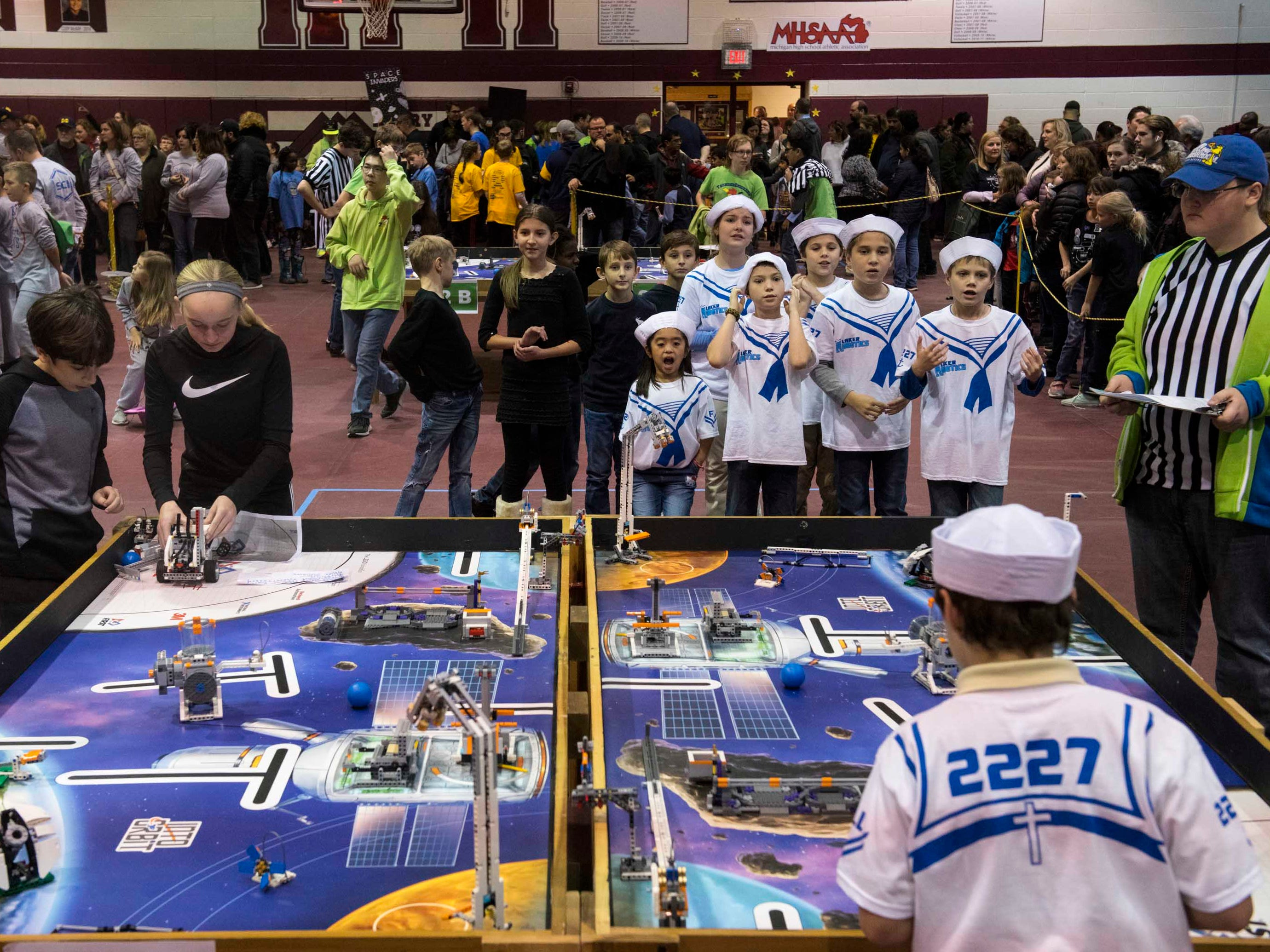 Members of the Lakes Robotics team of Our Lady of Lakes Catholic School of Waterford cheer for their teammates as they compete at ThunderQuest.