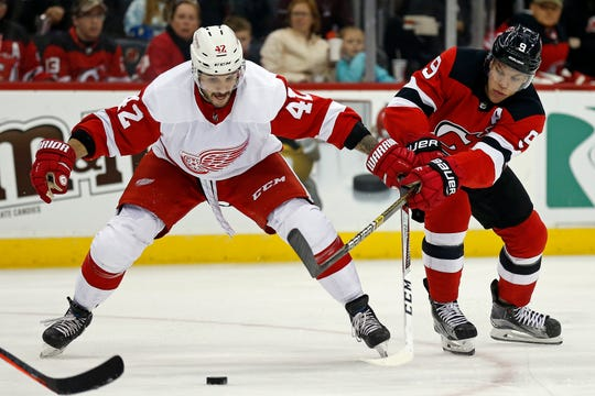 Detroit right wing Martin Frk battles for the puck with New Jersey left wing Taylor Hall earlier this season.