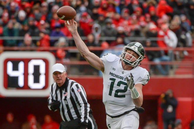 Michigan State quarterback Rocky Lombardi attempts a pass against Nebraska.