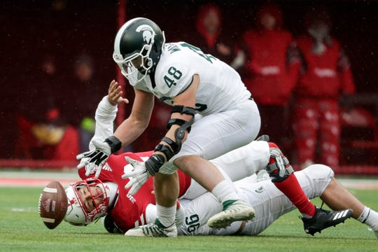Michigan State defensive end Kenny Willekes recovers a fumble for a turnover by Nebraska quarterback Adrian Martinez.