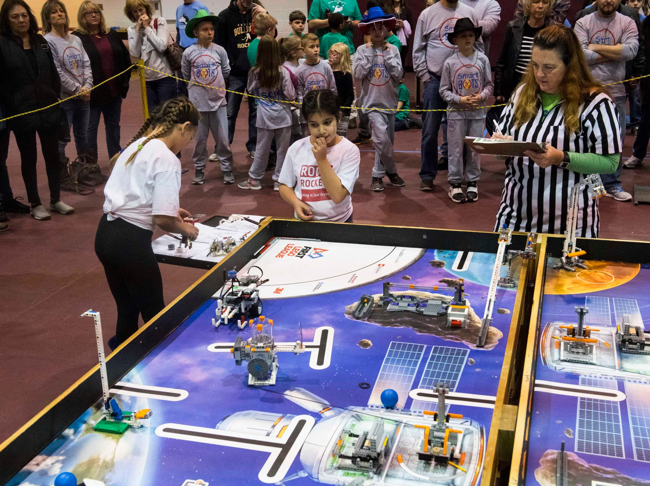 The Roose Rockets robotics team of Roose Elementary in Warren competes against the Smart Bots of Macomb, not pictured, at ThunderQuest.