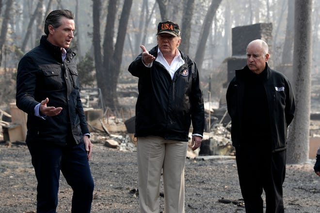President Donald Trump talks with Gov.-elect Gavin Newsom, left, and as California Gov. Jerry Brown listens during a visit to a neighborhood impacted by the wildfires, Saturday, Nov. 17, 2018, in Paradise, Calif.