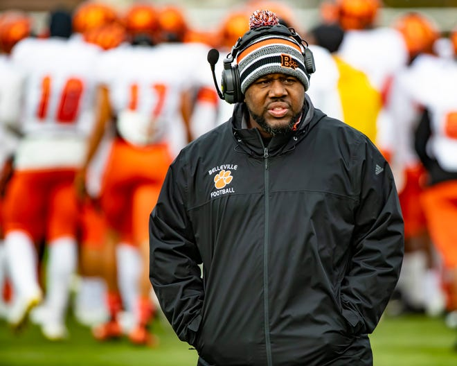 Belleville head coach Jermain Crowell walks the sidelines before Saturday's semifinal game.