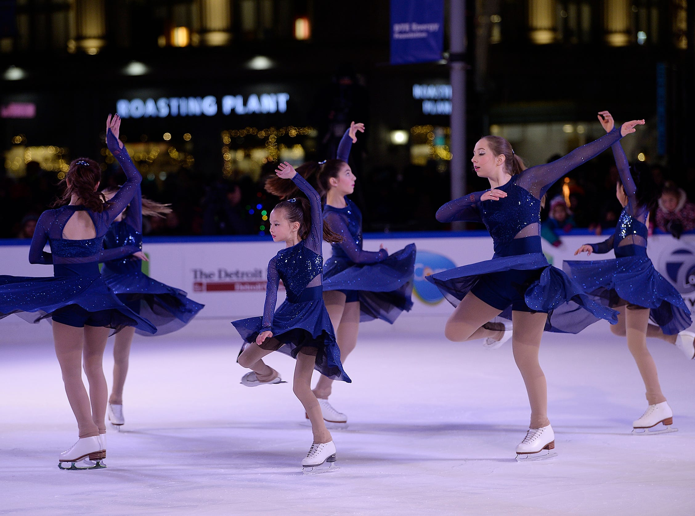 Members of the Arctic Figure Skating Club of Canton perform during the tree lighting ceremony at Campus Martius Park.