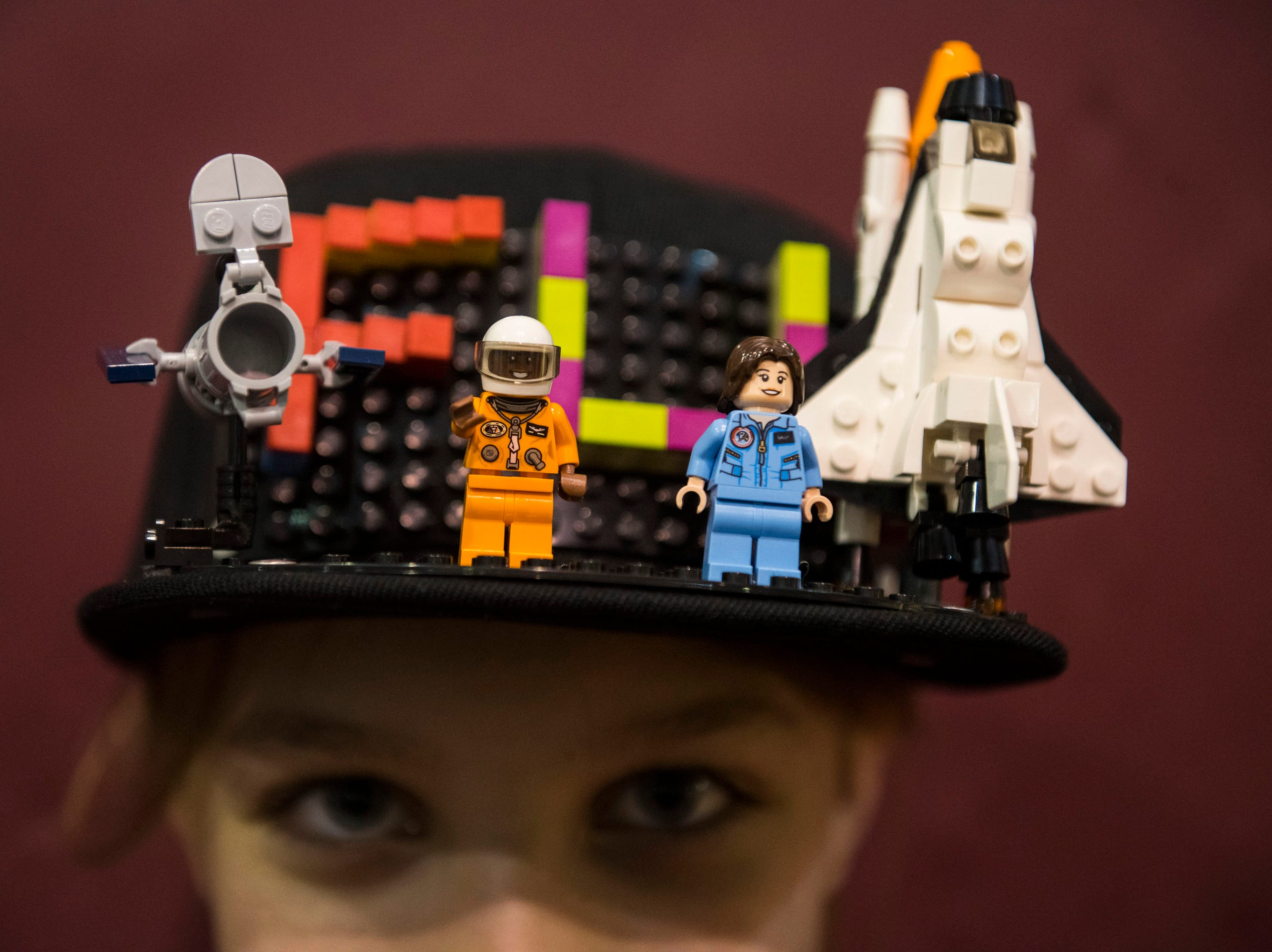 Natalie Palus, 11, of Shelby Township, a member of the Tuxedo Purritos robotics team, sports a hat embellished with Legos.