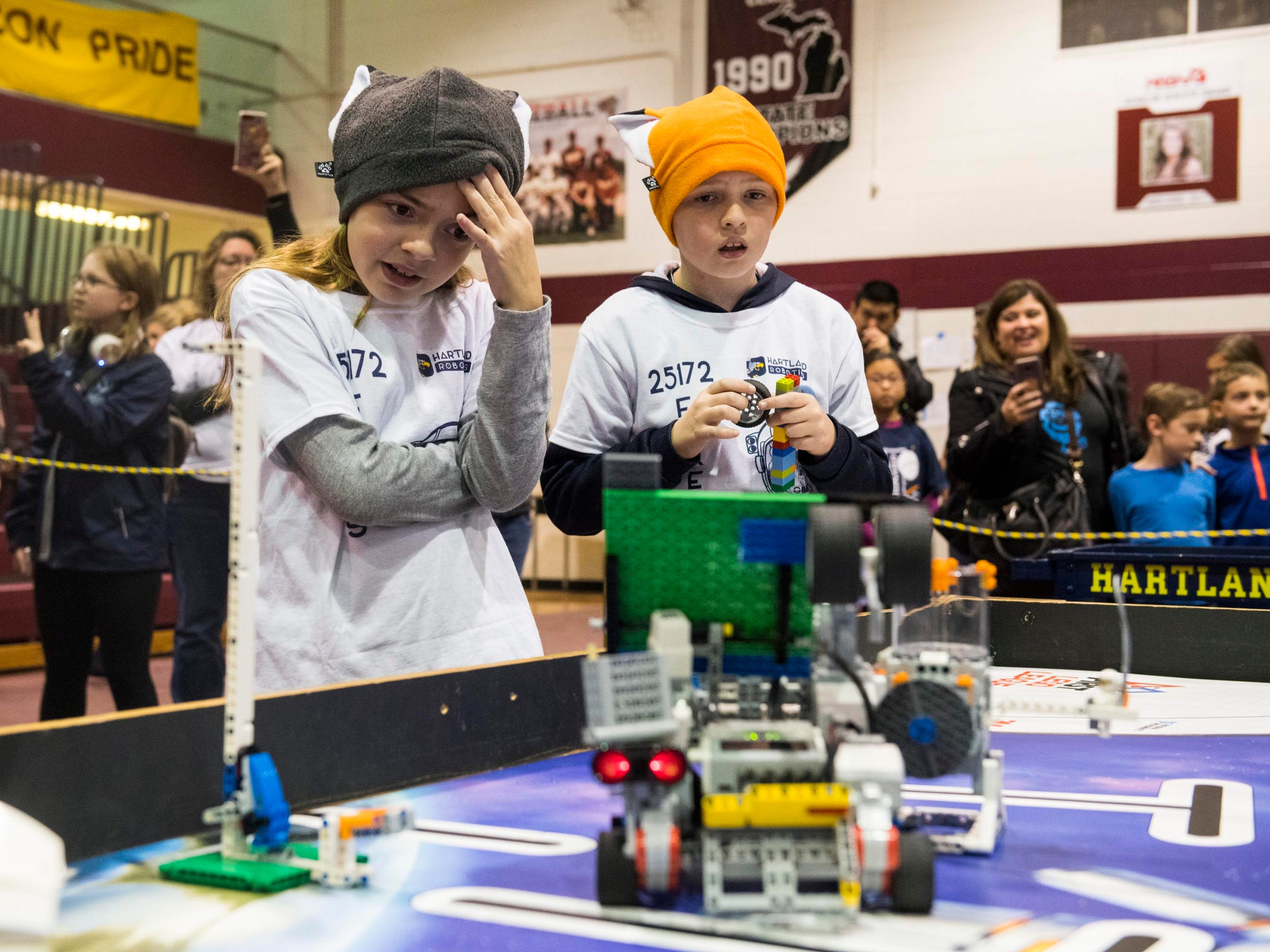 Charlee Jager, 10, and Carter Smith, 10, of the Hartland Robots team, watch their robot struggle to perform a move in the heat of their competitive round at the annual UCS ThunderQuest.