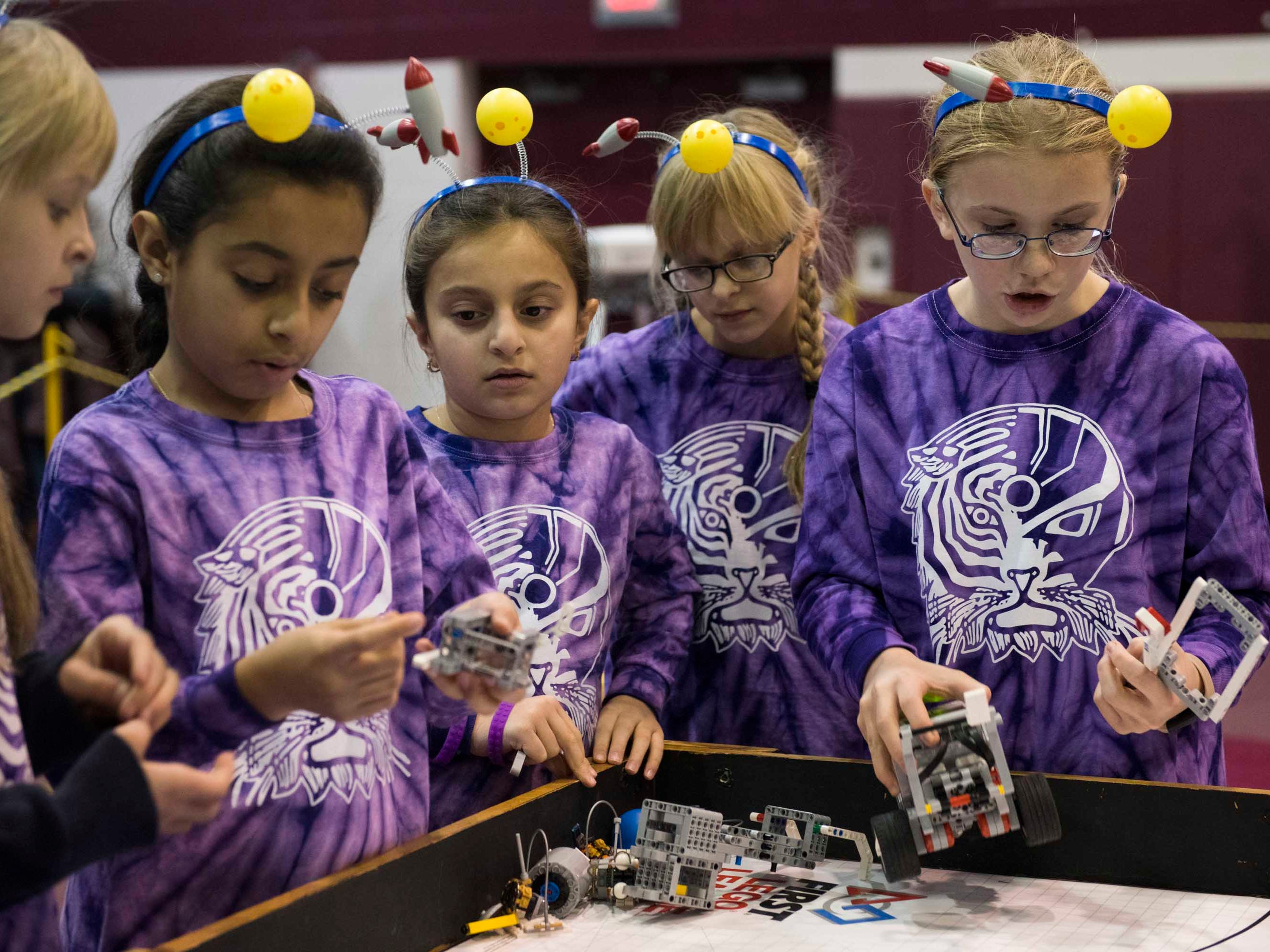 The Bengal Bots, a 4th-6th grade team from the Immaculate Conception School of Warren, prepare their robot for competition at the annual UCS ThunderQuest, a regional tournament for FIRST Lego robotics teams at Henry Ford II High School in Sterling Heights on Saturday, November 17, 2018.