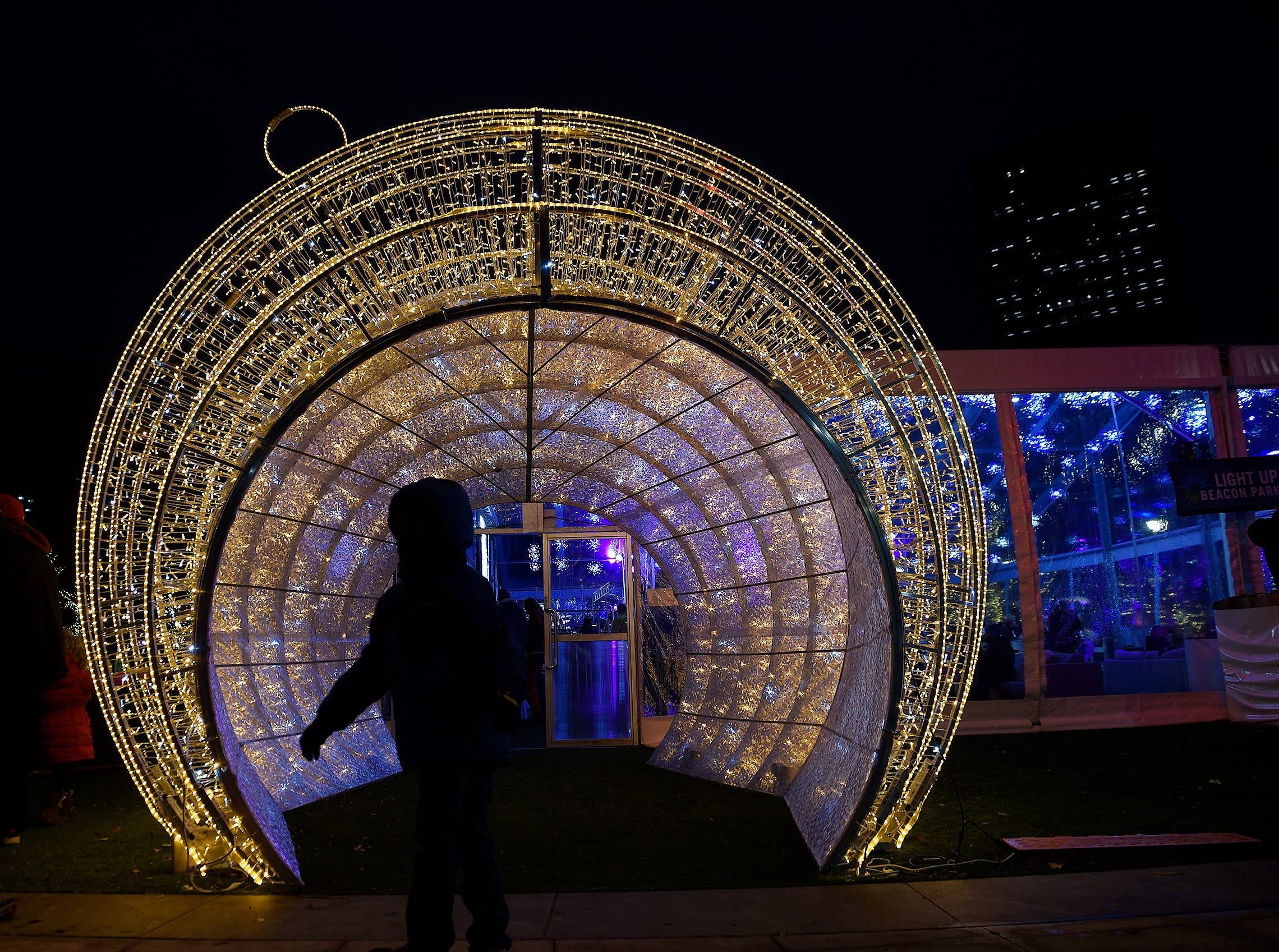 Christopher Sherar, 6, of Detroit walks through a large ornament.