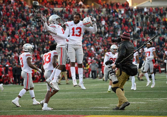 Ohio State cornerbacks Tyreke Johnson (13) and Kendall Sheffield celebrate after a victory over Maryland on Saturday.