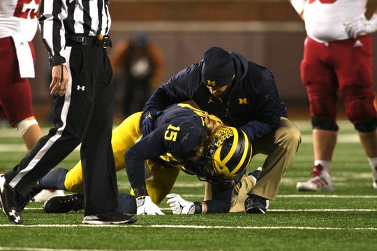 Michigan defensive lineman Chase Winovich lays on the ground after being injured in the third quarter.