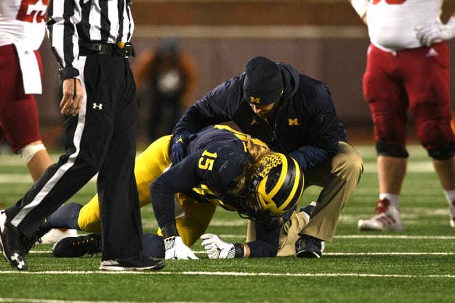 Michigan defensive lineman Chase Winovich lays on the ground after being injured during last weekend's game against Indiana.
