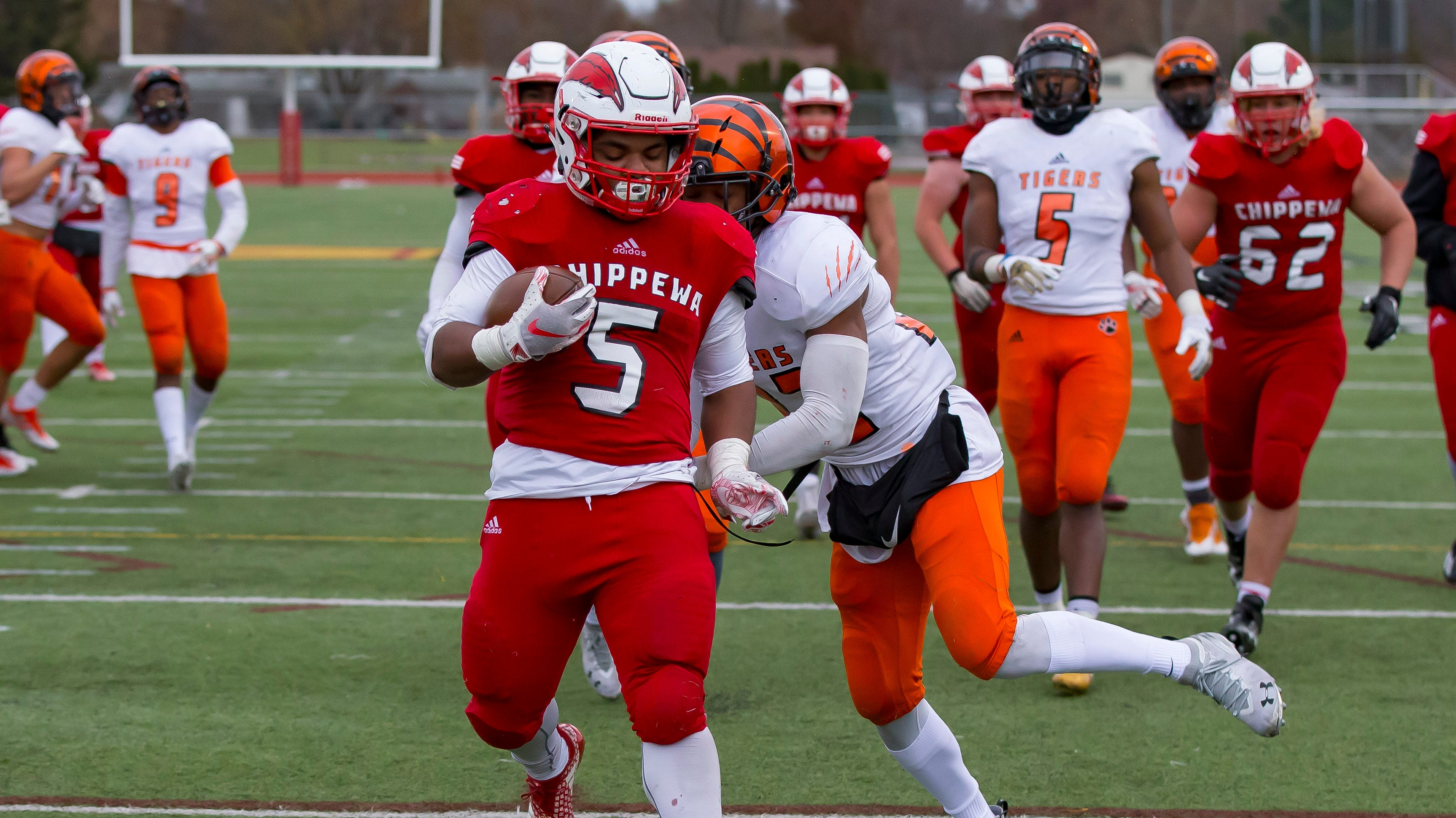 Andre Chenault (5) of the Chippewa Valley Big Reds scores a second half touchdown against the Belleville Tigers.
