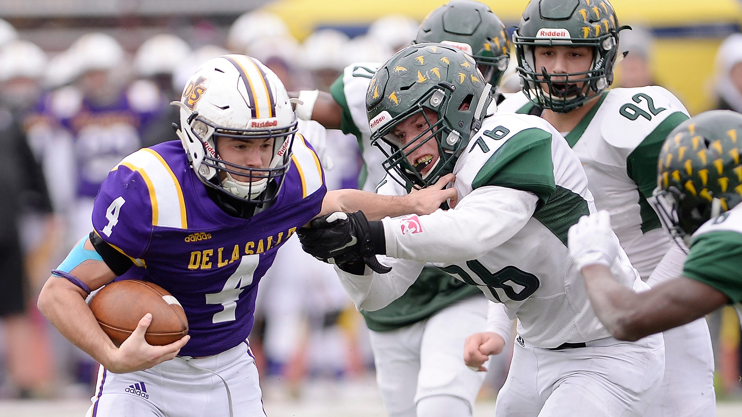 Warren De La Salle quarterback Nolan Schultz breaks the tackle of Birmingham Groves' Charlie Riddle in the third quarter.