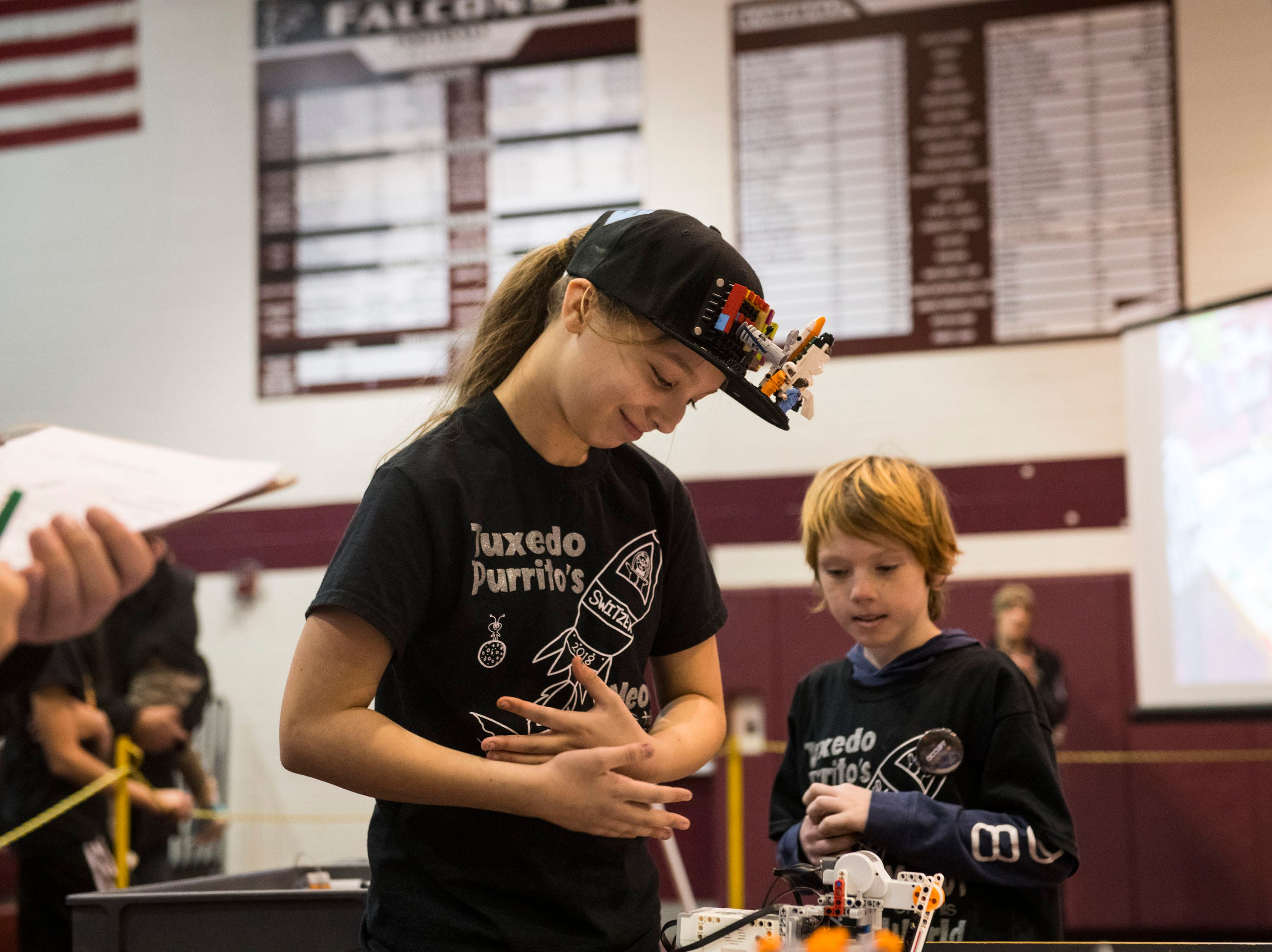 Natalie Palus, 11, of Shelby Township, a member of the Tuxedo Purritos robotics team, pauses after she and her teammate scored lower than they had hoped in a round of the competition.