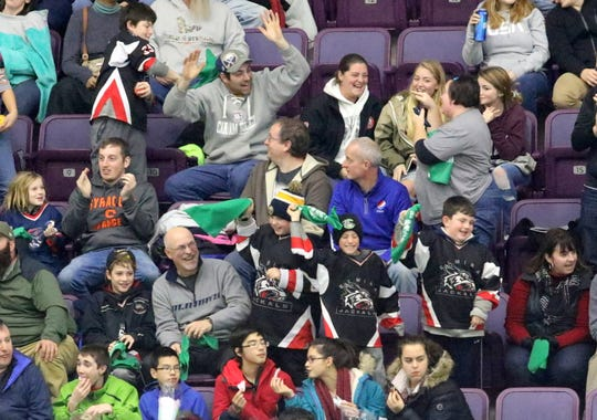 Elmira Enforcers fans celebrate the team's first-ever home goal Nov. 16, 2018 at First Arena against the Carolina Thunderbirds.