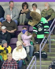 Elmira Enforcers mascot Captain K-9 greets a young fan during a game against the Carolina Thunderbirds on Nov. 16, 2018 at First Arena.
