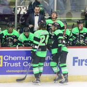 Elmira Enforcers head coach Brent Clarke talks to his players during a break against the Carolina Thunderbirds on Nov. 16, 2018 at First Arena.