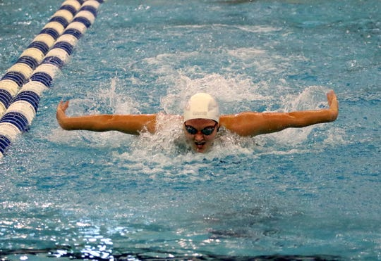 Summer Pierce of Owego swims to eighth place in the 100-yard butterfly at the New York State Girls Swimming and Diving Championships on Nov. 17, 2018 at Ithaca College.