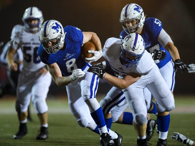 Memorial's Branson Combs (8) explodes past Bishop Chatard defensemen during the IHSAA Class 3A semistate championship at Enlow Field in Evansville, Ind., Friday, Nov. 16, 2018. The Tigers defeated the Trojans 42-17.